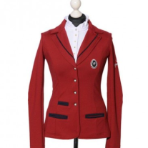 This jacket pushes the boundaries but the `bordeaux`colour is on the allowed FEI scale. It is also available in navy with light blue piping and black with grey piping. It also features the longer length of traditional dressage coats. Price: $499 USD from www.spooksriding.com.